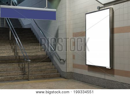 Blank billboard located in underground hall or subway for advertising mockup concept Low light speed shutter