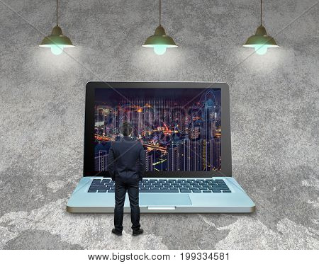 Businessman standing over the computer laptop on the concrete with part of world map background and writing the trading graph at the screen over the granite background Business trading and concept,3D illustration