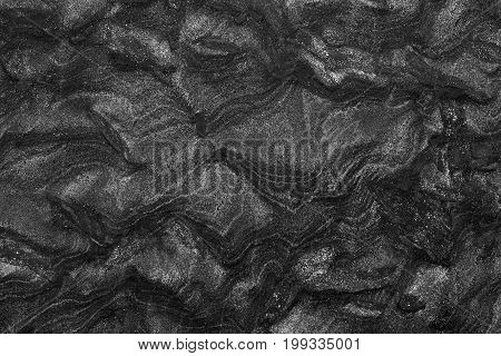 Black granite stone abstract background. High resolution photo.