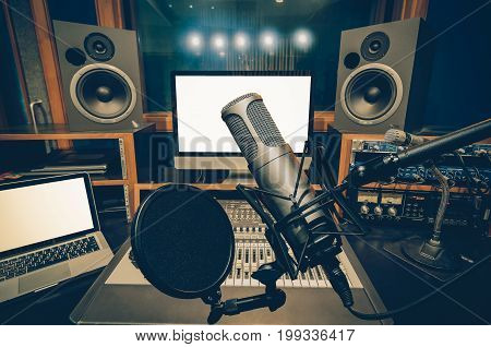Professional condenser studio microphone over the music studio background Musical instrument Concept