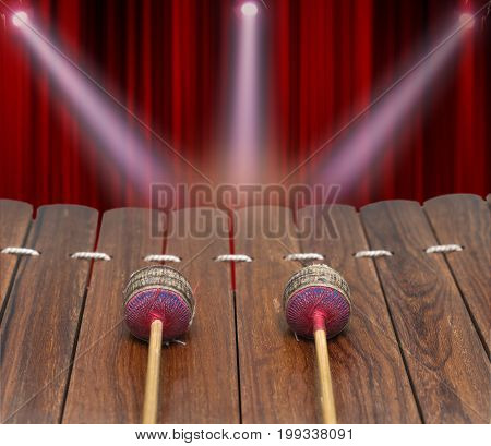 Closeup Thai musical instrument (Alto xylophone) on Realistic Red Curtain background asian instrumentinclude clipping path