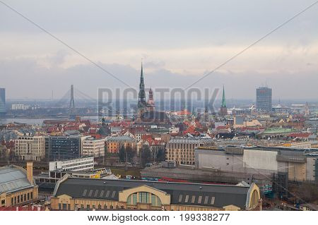 RIGA, LATVIA, 25 OKT 2015. Autumn cloudy aerial view of Riga old town, city market and river Daugava