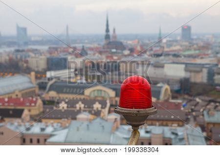 Led signal lantern on skyscraper and blurred cloudy arial view of Riga old town