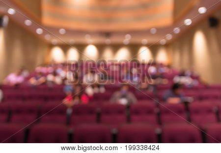 Abstract blurred photo of conference hall or meeting room with attendee background