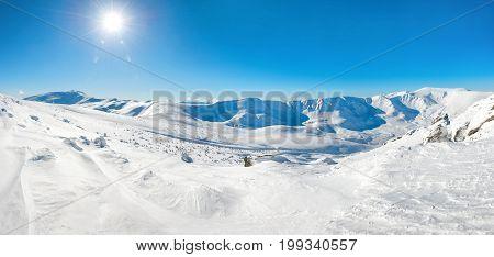 Panorama Of White Winter Mountains