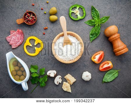 The Ingredients For Homemade Pizza With Herbs  Flat Lay On Dark Stone Background.