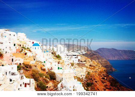 Oia, traditional greek white village townscape and caldera of volcano, Santorini, Greece, retro toned