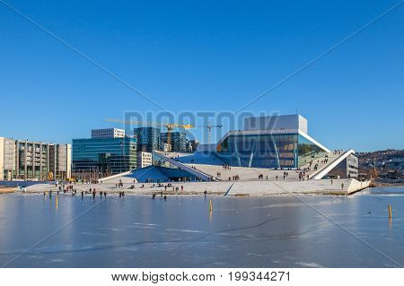 OSLO, NORWAY - 25 FEB 2015. The Norwegian National Opera and Ballet, and the national opera theatre. Winter icy view.
