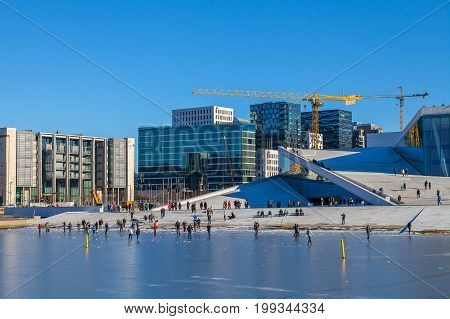 OSLO, NORWAY - 25 FEB 2015. The Norwegian National Opera and Ballet, and the national opera theatre. People enjoys ice walks.