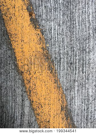 yellow lines on an asphalt road-narrow depth of field
