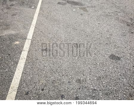 white lines on an asphalt road-narrow depth of field