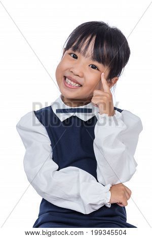 Portrait Of Asian Little Chinese Girl Thinking