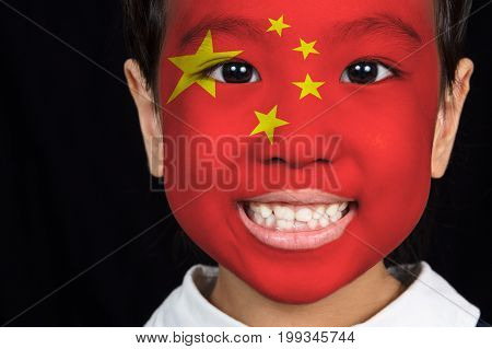 Asian Chinese Little Girl With Chinese Flag On Face