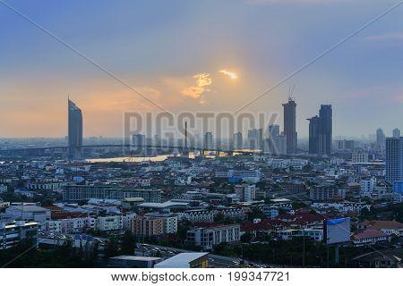 Beautiful cityscape of Bangkok in twilight viewing Rama IX Bridge and Chao Phraya river Thailand