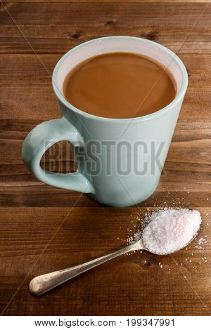 american coffee with milk and white sugar on a spoon