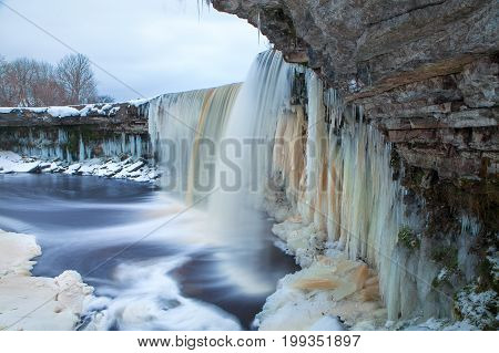 Winter icy and snowy waterfall in Estonia