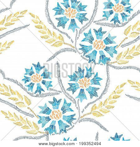 Elegant seamless pattern with hand drawn decorative cornflowers and wheat design elements. Floral pattern for invitations cards wallpapers gift wrap manufacturing fabrics. Embroidery style