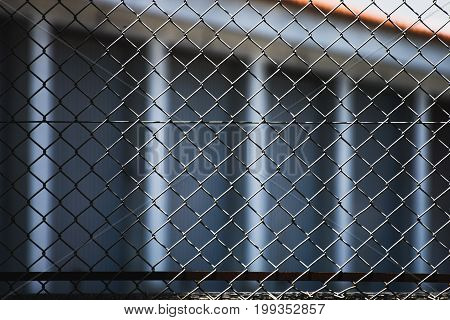 metal fence with a building in background