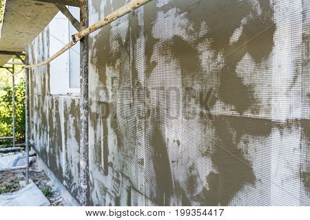 Technology Of Insulation Walls By Foamed, Layer Of Foam, Mesh, Solution Of Glue