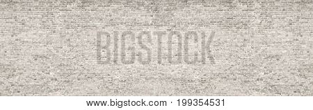 Vintage whitewashed brick wall panoramic background texture. Home and office modern design backdrop