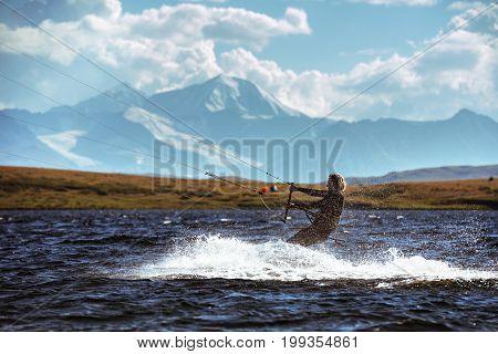 Kite surfing photo of woman in mountain lake