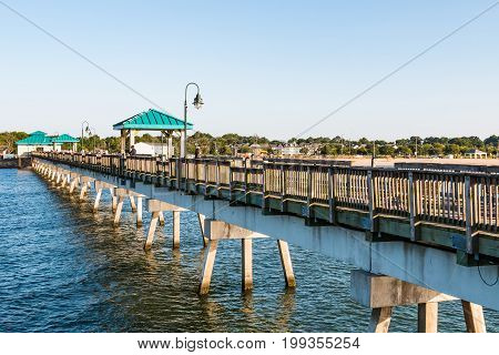 HAMPTON, VIRGINIA - JULY 9, 2017:  People on the 709-foot fishing pier at Buckroe Beach.  Originally the site of a plantation, Buckroe Beach now includes a beach, pier and public park.