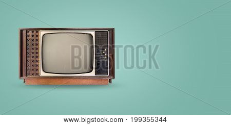 Retro television - old vintage tv on color background. retro technology. flat lay top view hero header. vintage color styles.