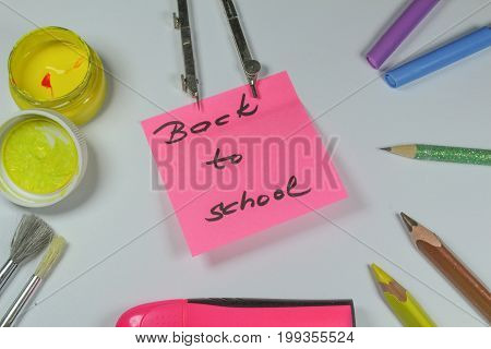 Sign ,,Back to school` on black background/This is notice ,,Back to school` on white background with school aids.