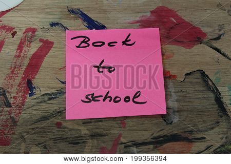 Sign ,,Back to school` on painting pallet/This is notice ,,Back to school` on painting pallet.