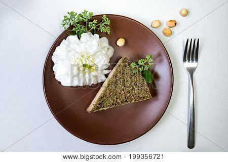 Piece of cake with on white background. Fresh flowers.