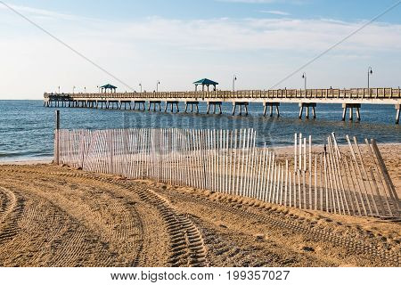 Beach fence images illustrations vectors beach fence for Buckroe beach fishing pier