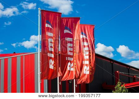 Tucums, Latvia - July, 2017: Rimi shop flags waving. Rimi Baltic is a major retail operator in the Baltic states based in Riga, Latvia.