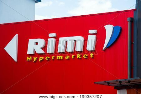 Tucums, Latvia - July, 2017: Rimi shop logo sign. Rimi Baltic is a major retail operator in the Baltic states based in Riga, Latvia.