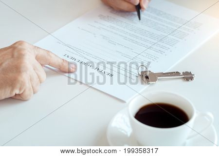 Man with real estate agent rent apartment signing contract