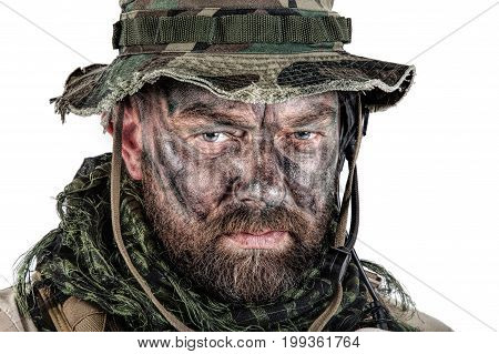 Special forces United States in Camouflage Uniforms studio shot. Wearing jungle hat, Shemagh scarf, painted face. Studio shot isolated