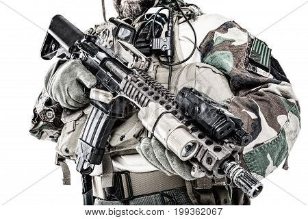 Special forces United States in Camouflage Uniforms studio shot. Holding weapons. Studio shot isolated, cropped