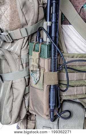Army radio in the pouch closeup shot folding antenna