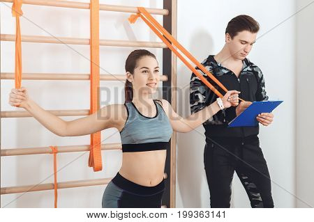 Young man and woman training in gym body workout flexibility