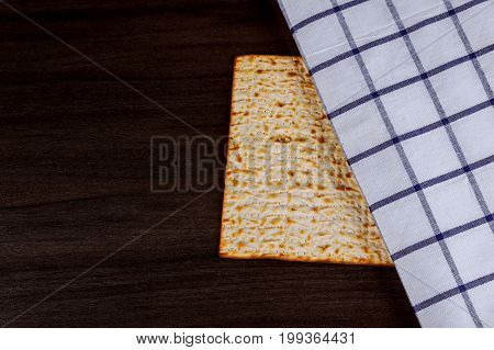 Matzoh for jewish holiday Passover pesah on wooden background. View from above