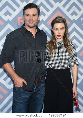 LOS ANGELES - AUG 08:  Tom Welling and Lauren German arrives for the FOX TCA Summer Press Tour 2017 on August 8, 2017 in West Hollywood, CA