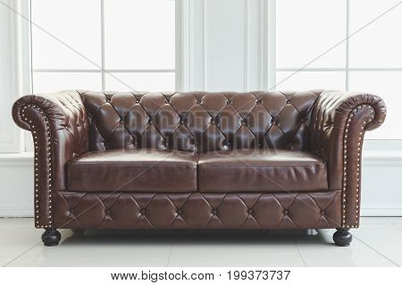 Beautiful vintage in interior leather sofa next to wall with concept of decoration retro-style illustration
