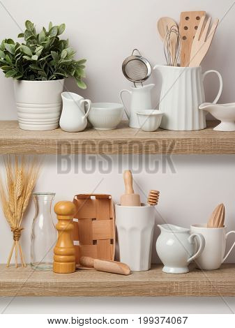 Kitchen Utensils And Dishware On Wooden Shelf.