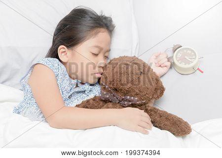 Asian Cute Girl Sleep  With Alarm Clock