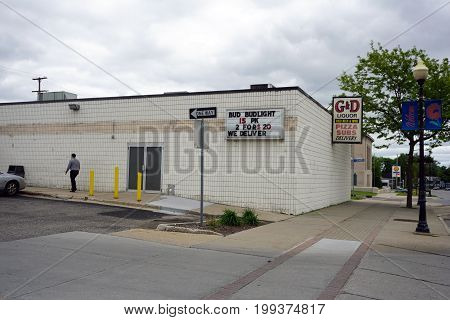 CADILLAC, MICHIGAN / UNITED STATES - MAY 31, 2017:  The G and D Liquor Store offers pizza, sandwiches, cold beer and wine, on Mitchell Street in Downtown Cadillac.