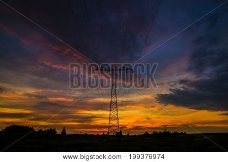 Sunset behind the electricity pylon in Germany