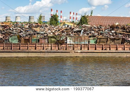 Heap Of Scrap Metal On The River Bank