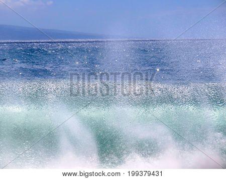 Sea Spray - Wave crashing on the beach in Kaanapali, Maui.