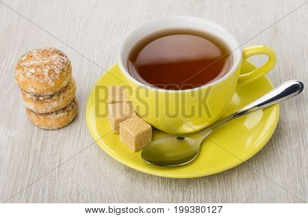 Cup Of Tea, Sugar, Spoon And Stack Of Honey-cake
