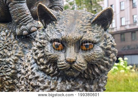MINSK, BELARUS - AUGUST 04, 2012: City bronze sculpture of cat near the Belarusian state circus. The sculpture was installed in 2010. Sculptor Sergey Bondarenko.