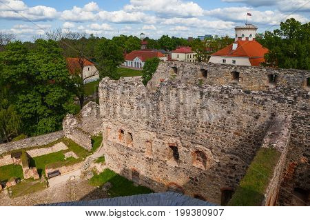 Aerial view of beautiful ruins of ancient Livonian castle in old town of Cesis, Latvia. Greenery and summer daytime.